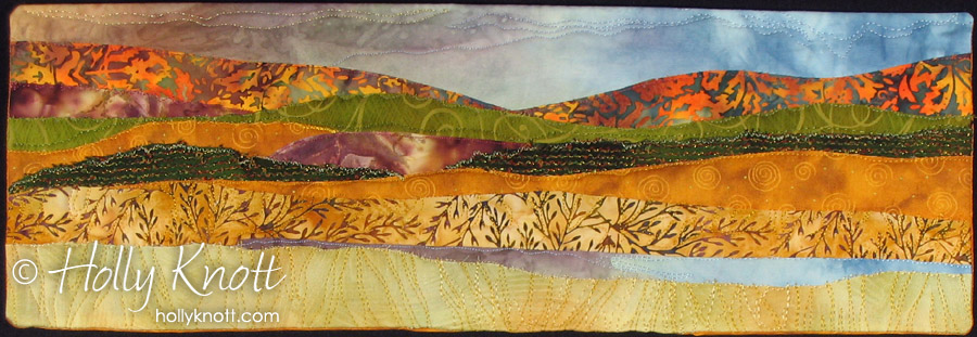 landscape art quilt by Holly Knott of a lake in autumn