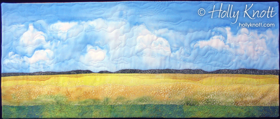 Art quilt of a field of canola, by Holly Knott
