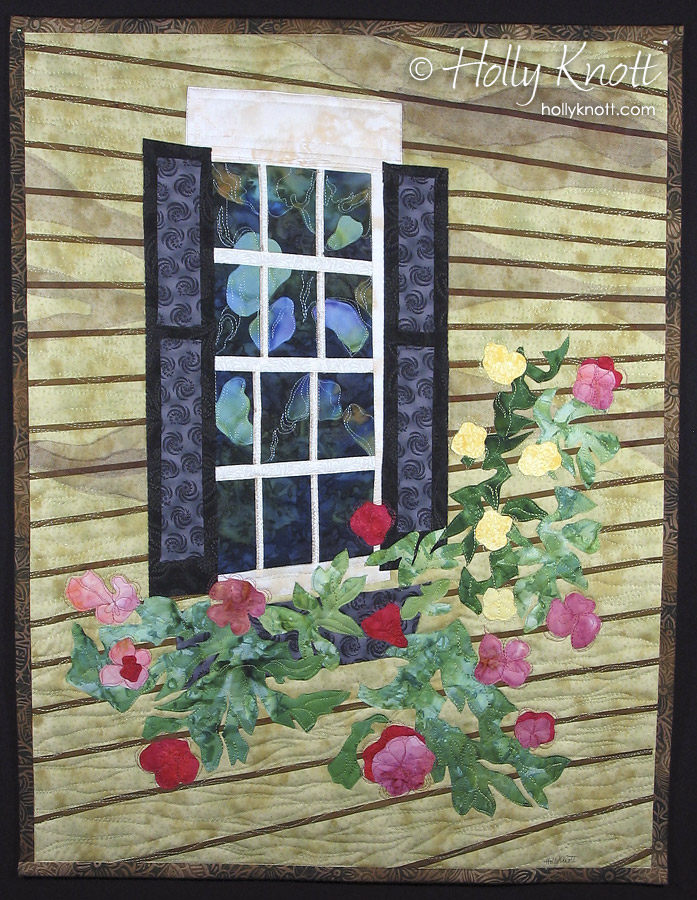 Art quilt by Holly Knott of reflections in an old window and a flower box